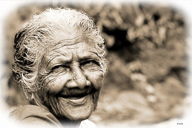 Inspirational smile from an older woman working in the streets in India.